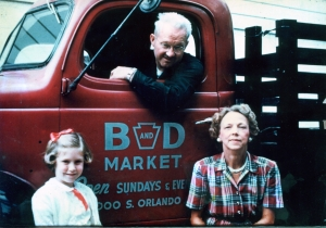 Joy Wallace Dickinson (left) with grandparents Bill and Alice Wallace and the truck for the family's new business, the B&D Market in Winter Park.