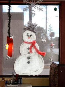 A painted snowman, seen from inside Christo's Cafe on Edgewater Drive in Orlando's College Park.
