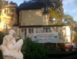 Half of the historic Capen House rests after its move in Winter Park, Fla., near a statue of Pan at the Albin Polasek Museum and Sculpture Gardens.