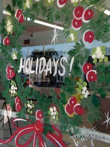 Hand-painted wreaths by artist Donna Miniere greet customers at Jon's Cleaners in Orlando, Dec. 20, 2013.